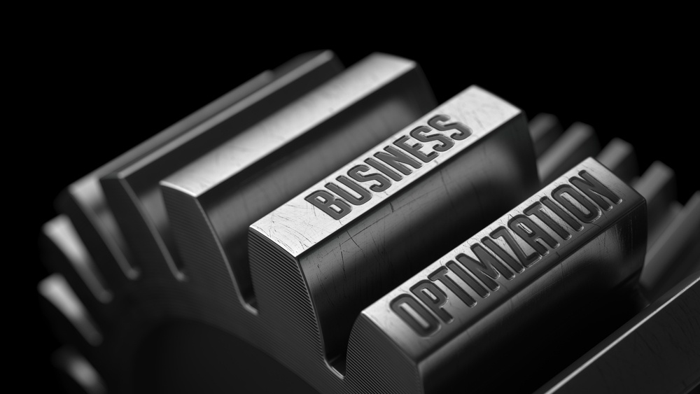 Business Optimization on the Metal Gears on Black Background.
